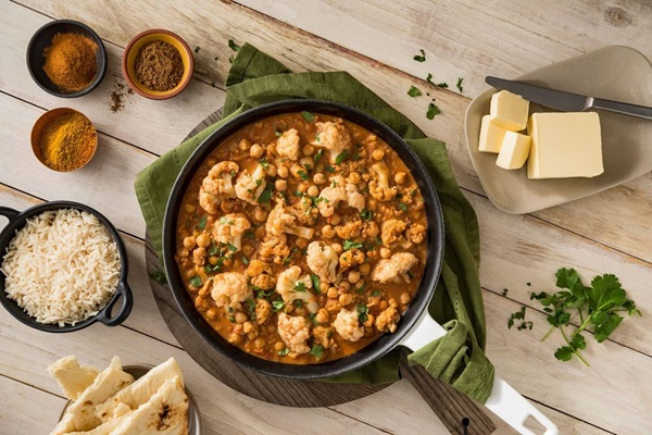 "recipe image Vegan Indian ""Butter Chickpeas"" & Cauliflower"